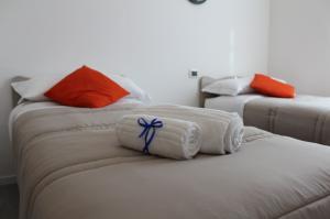 Seconda camera da letto con 2 letti singoli e 1 divano letto