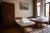 Single beds and private lockers in E room